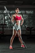 Beautiful Sports Fitness Girl With A Barbell