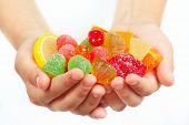 Child hands with colorful fruity candy