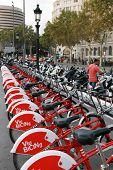 Red Bicycles For Rent On The Placa De Catalunya In Barcelona