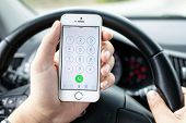 Driver In The Car Dials The Number Iphone 5S Gold