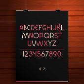Latin alphabet on the wooden background