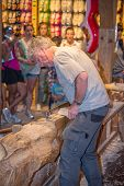 Craftsman Shows Art Of Manufacture Of The Clogs