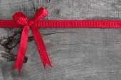 Top view of red ribbon decoration on wooden background