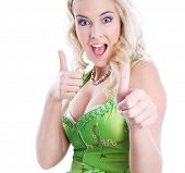 Isolated blonde bavarian with dirndl on the oktoberfest and thumbs up.