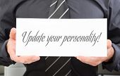 Businessman holding board with