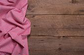Checkered fabric as border on wooden background for christmas or for a menue card in a restaurant or for advertising or publicity