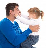 Dad and child playing and pinching cheeks isolated on white background