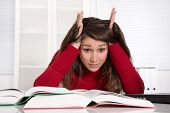 Young businesswoman has concentration problems at studying or at work