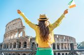 Young Woman With Italian Flag Rejoicing In Front Of Colosseum In