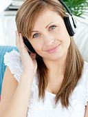 Portrait Of A Delighted Woman Listen To Music With Headphones