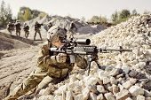 stock photo of offensive  - Sniper covers offensive squad of rangers team - JPG