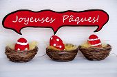 Three Red Easter Eggs With Comic Speech Balloon French Joyeuses Paques Means Happy Easter