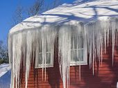 stock photo of dam  - Ice dams and snow on roof and gutters after bitter cold in New England - JPG