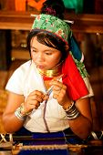 Portrait Of Kayan Lahwi  Girl Is Weaving.