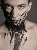 Dramatic Fashion Art Portrait Of Man In Black Paint