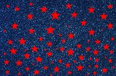 Red stars on blue glitter background