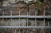 image of old stone fence  - Snow of an old fashioned metal fence - JPG