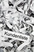 shredded paper tagged with customer lists, symbolic photo for customer information and privacy