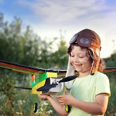 children with airplane toy outdoors, airplane is hand made not copyright