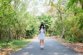 A Cute Asian Thai Girl Is Standing On A Spring Forest Path Alone