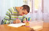 foto of health center  - young adult man engages in self study in rehabilitation center - JPG