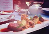 Medium rare fried duck breast with fried onion and sauerkraut, modern czech cuisine, toned image