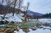 Mountain River On Wintertime