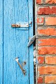 Blue Painted Wooden Door With Latches