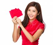 Chinese woman hold red pocket for good fortune