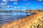 View towards Poole harbour and quay Dorset England UK in vivid HDR like painting