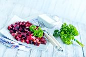 stock photo of beet  - beet salad on plate and on a table - JPG