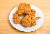 Fried Chicken On White Plate And Wood Table
