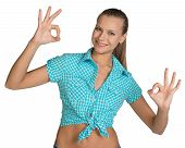 Pretty girl in shirt showing ok hand signs. Full length
