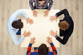 Top view of people with hands on table