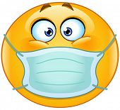 Yellow ball with medical mask over mouth