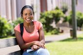 happy african american college student outside campus