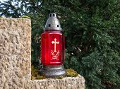 Red grave lantern with golden cross