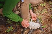 Woman Tying A Shoelaces Outdoor