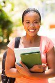beautiful african university student holding books