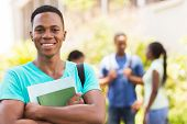 portrait of black male college student holding books