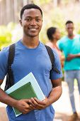 pic of handsome-male  - handsome young male student holding books - JPG