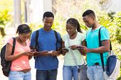 modern african college student using their cell phones