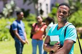 portrait of handsome male african college student looking at the camera