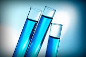 Test-tubes with blue fluid, close-up