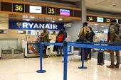 VALENCIA, SPAIN - FEBRUARY 14, 2015: Passengers at a Ryanair check-in counter at the Valencia airport. In 2014, Ryanair was the largest European airline by scheduled passengers carried.