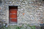 Old Door In Stone Wall