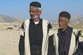 Men wear traditional dresses circa Isfahan, Iran