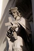 GRAZ, AUSTRIA - JANUARY 10, 2015: Saint John of Nepomuk on the facade of Parish Church of the Holy Blood in Graz, Styria, Austria on January 10, 2015.
