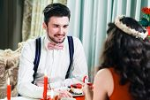 marriage proposal, man give ring to his girl, young happy couple romantic date at restaurant, celebr