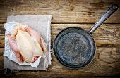 image of crude  - fresh crude farmer chicken on a wooden background - JPG